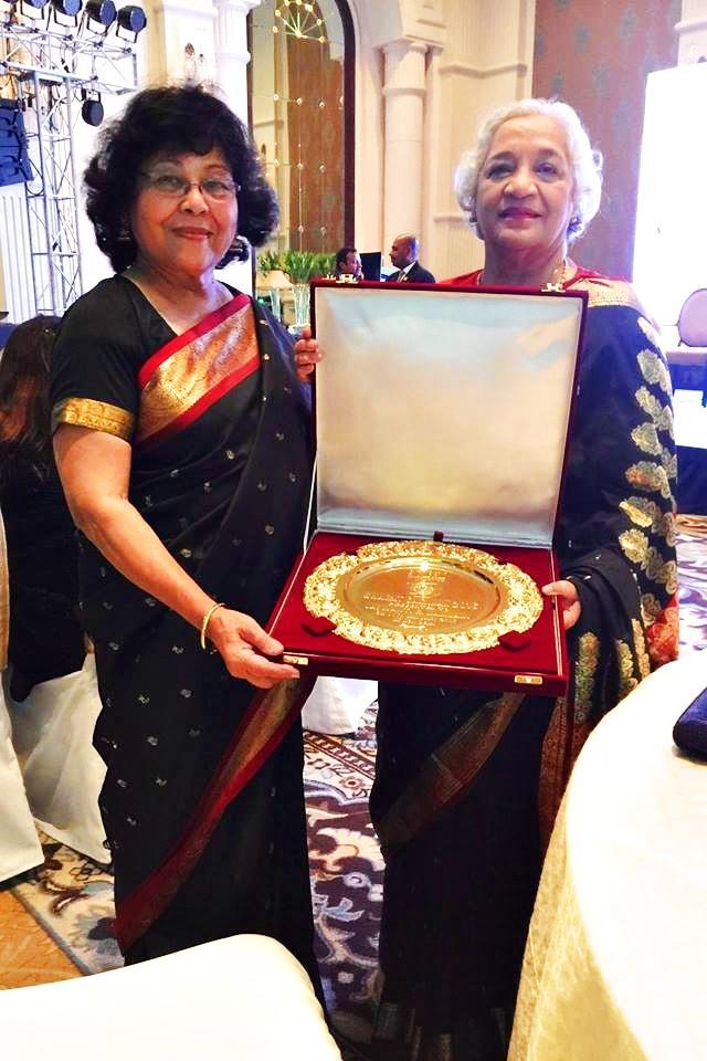 Photo of Jaya Kamlani displaying her Bharat Samman award. Her friend Meena Sharma, Seattle U.S., accompanied her to the awards ceremony.